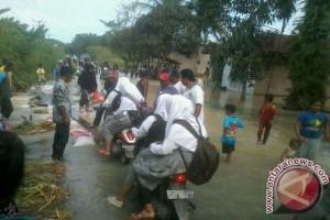 Tanggul Pecah,  Dua Dusun Terendam Banjir